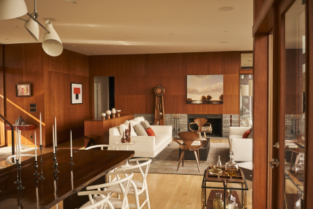 The-living-room-is-awash-in-modern-20th-century-furniture-from-the-cherner-armchairs-to-the