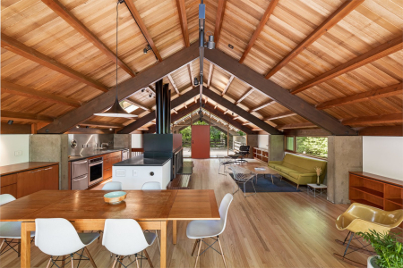 The-houses-second-floor-where-one-enters-combines-the-living-kitchen-and-dining-areas-in-one-space-beneath-original-architect-richard-campbells-vaulted-wood-ceiling